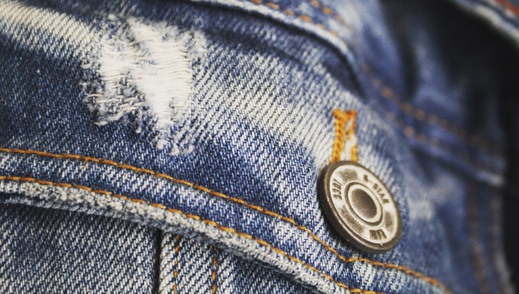 close-up-of-denim-pants-with-button