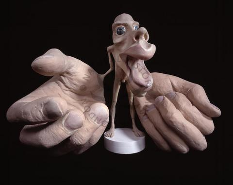 humanoid statue with large hands and head