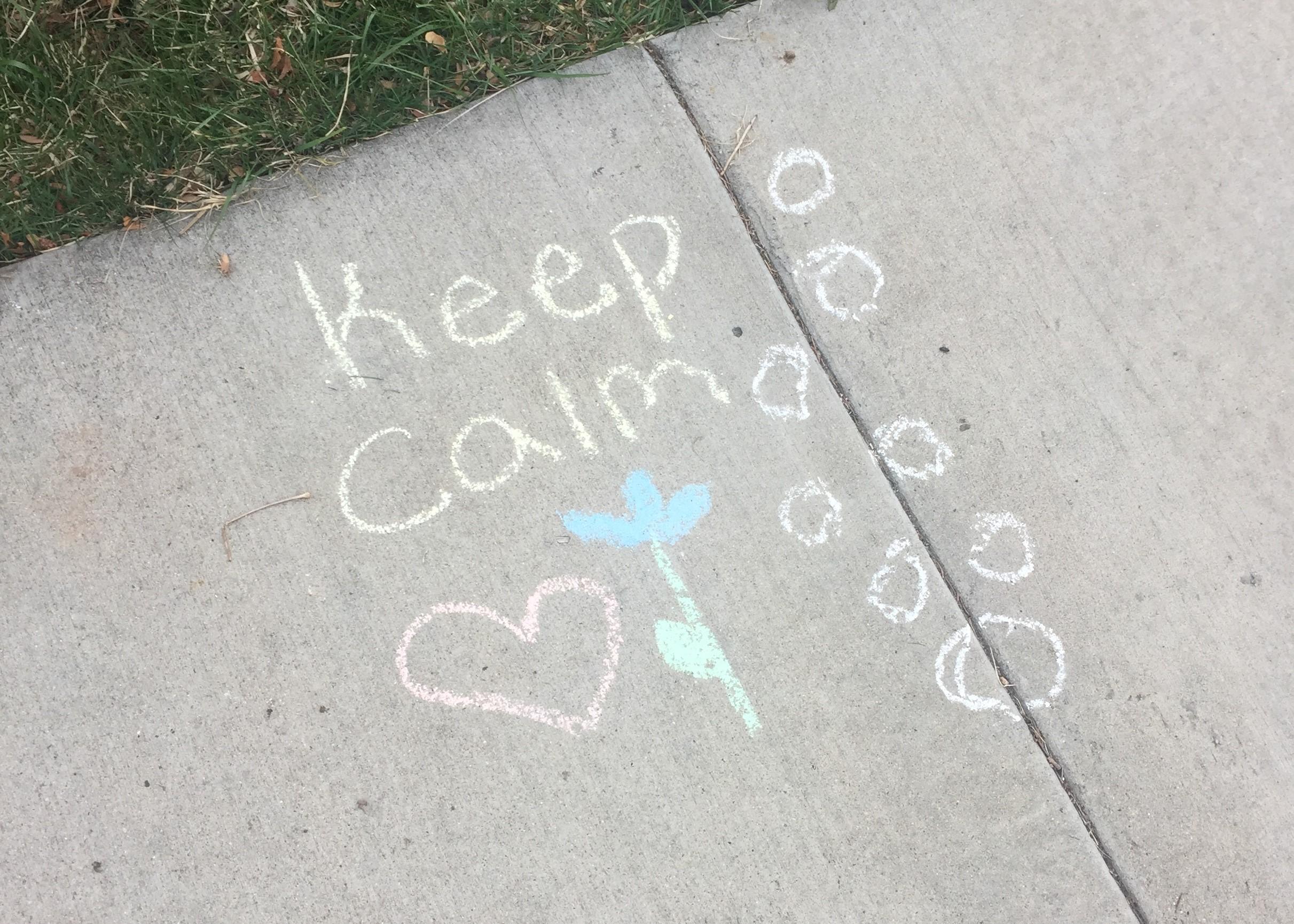 keep-calm-written-in-sidewalk-chalk-with-pink-heart-and-blue-flower