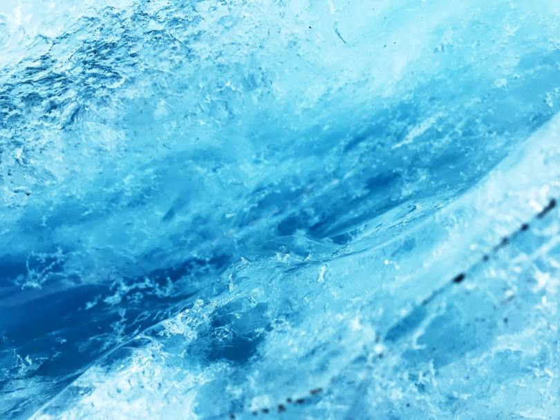 light-and-dark-blue-in-close-up-of-glacial-ice