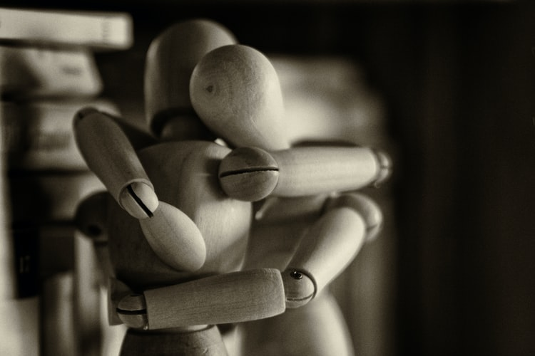 two-drawing-mannequins-embracing-in-black-and-white-as-depression-in-men-concept