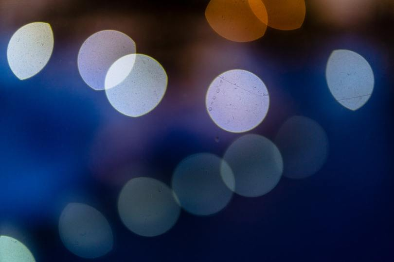large-translucent-orbs-of-blue-and-purple-tones-on-dark-blurry-background